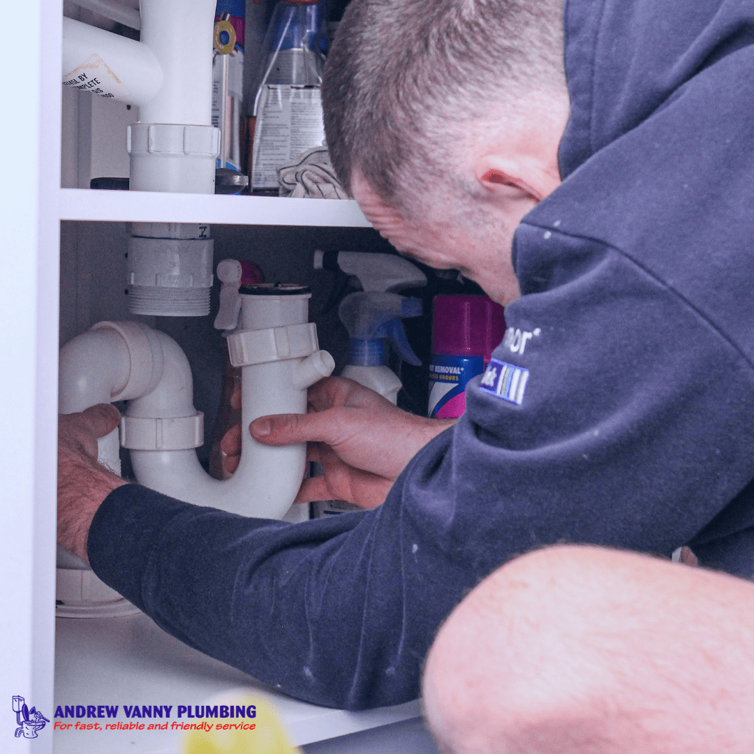 Thornleigh plumber at work under the sink